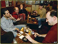Pub-goers in Dublin enjoying their last cigarettes