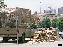 Saudi soldiers man a checkpoint in the eastern city of al-Khobar, scene of the siege over the weekend, near a group of residential compounds
