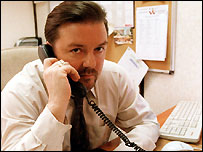 Ricky Gervais starring as David Brent in The Office