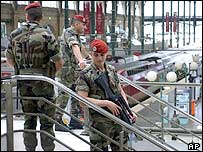 French soldiers patrol at the Gare du Nord train station in Paris