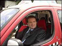 Bogoljub Karic at wheel of taxi
