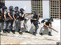 Police officers surround Urso Branco prison in Rondonia in 2004, where inmates staged a revolt