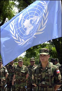Chilean soldier stands by UN flag in Haiti
