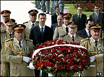 President Bashar al-Assad surrounded by military officers on Martyrs Day