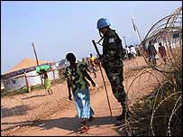 Bunia refugees and peacekeepers (� Kate Holt / eyevine)