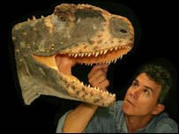 Paul Sereno with a reconstruction of Rugops, AP