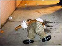 The body of a gang member shot by a rival gang in LA