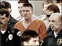 Timothy McVeigh, the Oklahoma bomber, is led away from court