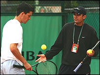 Tim Henman being coached by Paul Annacone