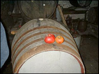 Cider barrel with apples on top