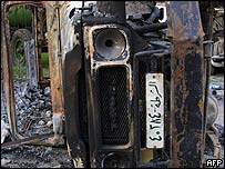Burnt out police car in Syrian town of al-Qameshli