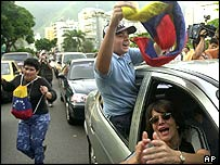 Chavez opponents in Caracas on news of a possible referendum