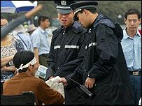 Police confront a protester in Tiananmen Square