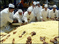 Algerian chefs put the finishing touches to giant couscous