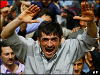 Kurds celebrate the fall of Saddam Hussein