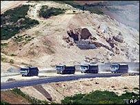 South Korean lorries carry North Korean sand for road-building work