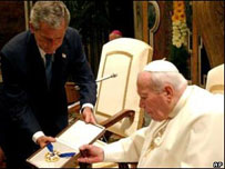 President Bush presents the Pope with the Presidential Medal of Freedom