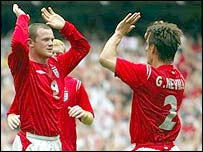 Wayne Rooney celebrates with Gary Neville