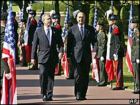 George W Bush with his French counterpart Jacques Chirac at Colleville