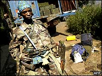 A soldier of the dissident troops guards a truck filled with ammunition, 6 June 2004