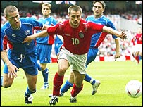 Michael Owen holds off a defender in England's thrashing of Iceland