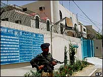 Pakistani police officer stands in front of the UNHCR office in Quetta, 6 June 2004