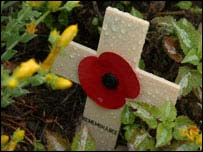 Poppy cross in Normandy graveyard