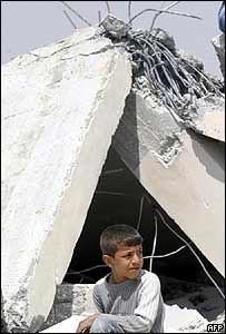 Palestinian child beside his demolished home in east Jerusalem