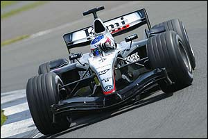 Kimi Raikkonen at Silverstone's Luffield corner in the new McLaren MP4-19