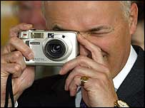 Iain Duncan Smith tries out a digital camera