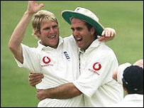Matthew Hoggard (left) and Michael Vaughan celebrate the wicket of Chris Cairns
