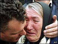 Kosovo Serb woman cries after fleeing her home