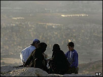 Palestinian refugees on a hill overlooking Baqa'a camp in Jordan
