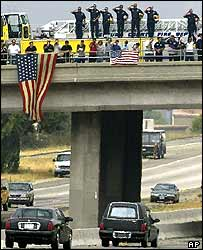 Onlookers watch Reagan's hearse