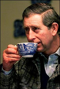 Prince Charles drinks a cup of tea