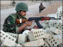 Iraqi soldier on guard near Falluja