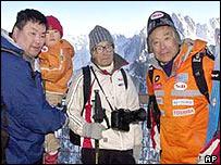 Keizo Miura (centre), taken in 2003 when he was 99
