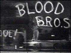 Blood brothers sign painted on shop window