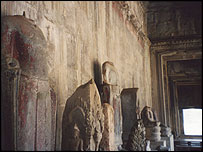 Statues with no heads in Angkor Wat