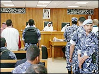 Russian agency (left, wearing white) stands in Qatar court room
