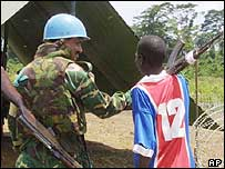UN peacekeeper in Liberia, with rebel fighter