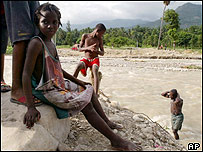 A group of Haitian children near a flooded river
