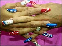 Flojo was memorable for her decoratively painted nails