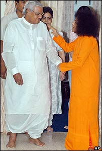 Sri Satya Sai Baba, (right) blesses former Indian prime minister Vajpayee (left) in  April 2004