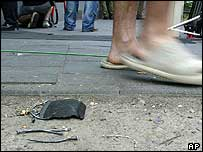 A passer-by passes nails on the ground near the explosion