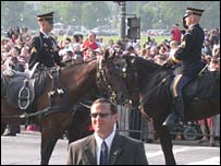 A Secret Service agent along the procession route