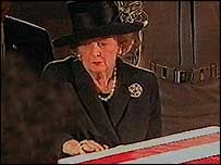 Margaret Thatcher caresses Ronald Reagan's coffin
