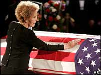Nancy Reagan places her hand on her husband's coffin as it lies in the Capitol, 9 June 2004