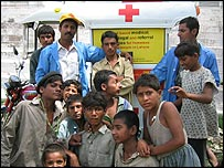 A group of outreach workers and children in Lahore