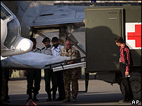 The body of a worker for MSF in Afghanistan is unloaded from a helicopter